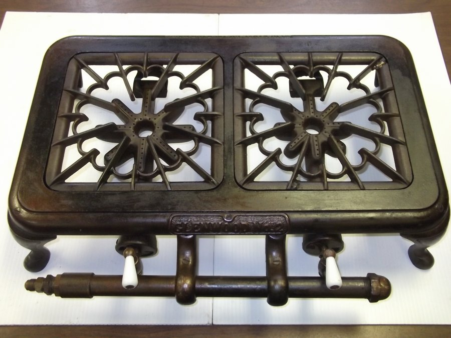 What's a 1918 ANTIQUE GLENWOOD NO.2 CAST IRON DOUBLE BURNER PROPANE/GAS HOT PLATE STOVE worth?  Picture