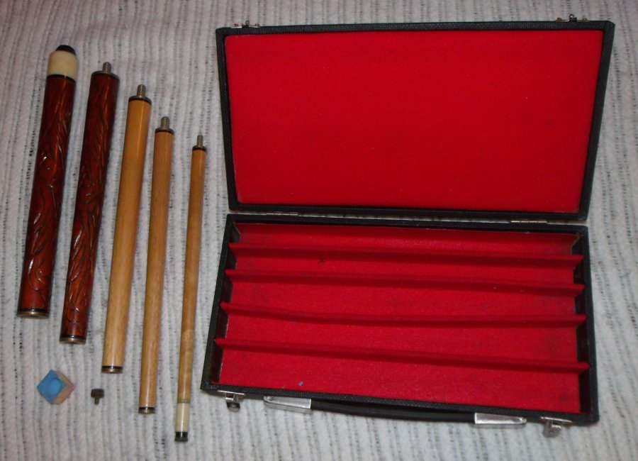 What's 'antique carved wooden take apart pool cue 5 pieces' Worth? Picture