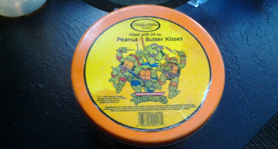 What's '1990 holiday delights peanut butter kisses teenage mutant ninja turtles tin' Worth? Picture
