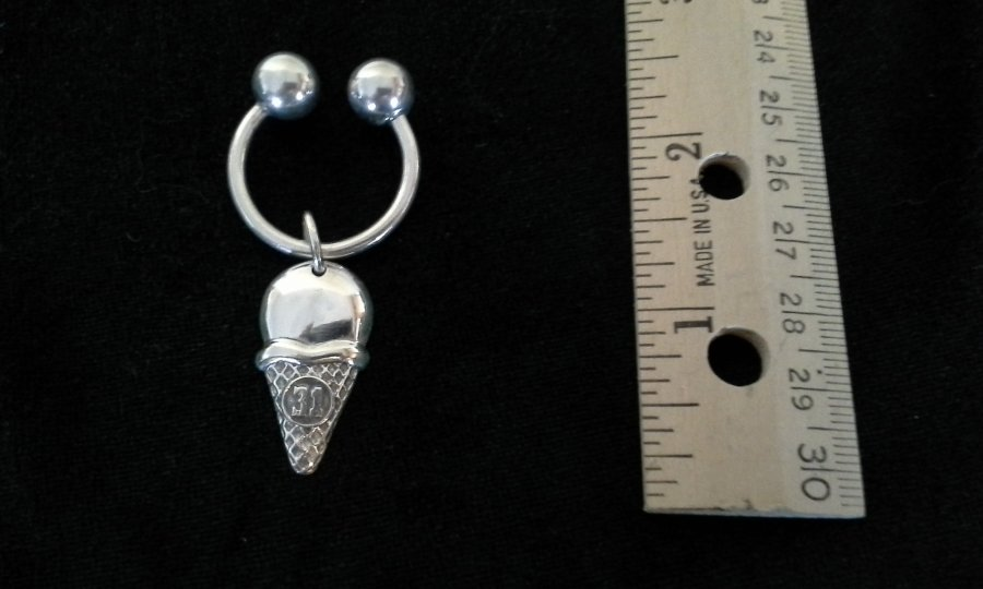 What's 'Tiffany silver key ring with Baskin Robbins ice cream cone pendant.' Worth? Picture