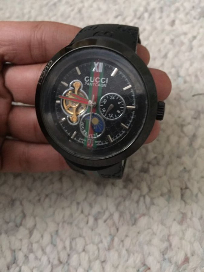 What's 'men's Gucci watch REF 1142' Worth? Picture